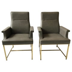 Pair of Grey Leather Armchairs on Brass Bases