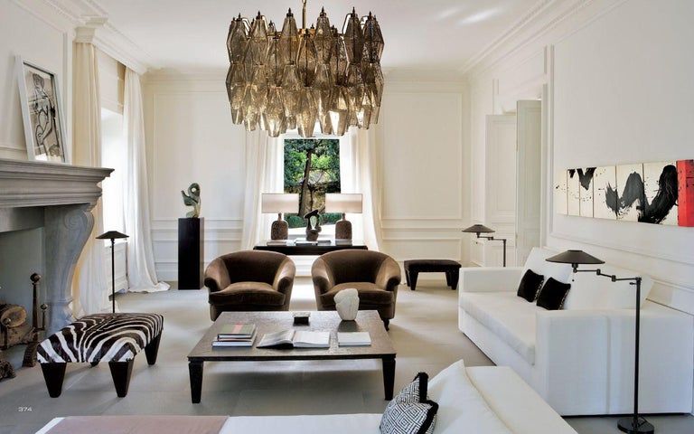 Each chandelier consists of 103 hand blown grey