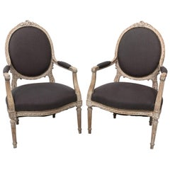 Pair of Grey Upholstered Louis XVI Style Armchairs, circa 1820