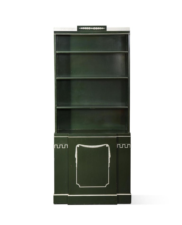 Pair of Grosfeld House bookcases in Forrest green lacquer with silver detailing. Interior shelving at bottom section.