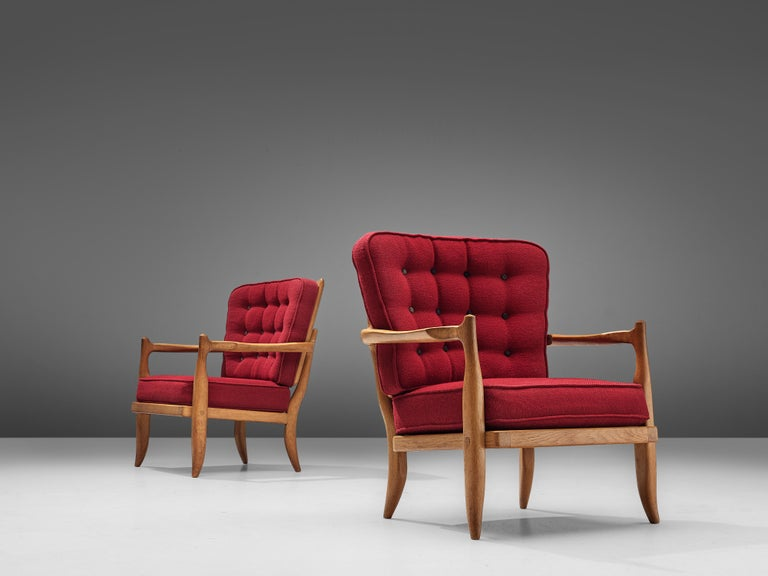 Guillerme and Chambron, set of two easy chairs, oak, red upholstery, France, 1950s  Characteristic pair of lounge chairs by French designer duo Guillerme et Chambron. The seating as well as the backrest are made of comfortable cushions,