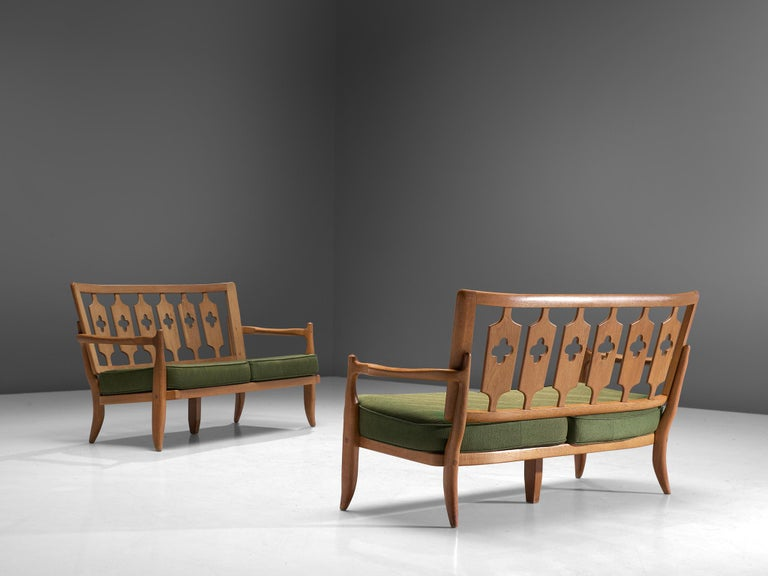 Guillerme et Chambron, pair of sofas, oak and fabric, France, 1960s.