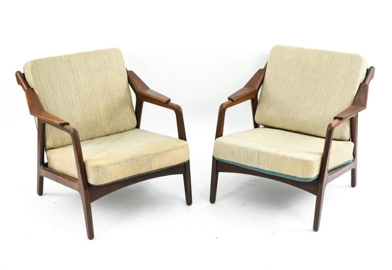This is a fabulous pair of lounge chairs designed by H. Brockmann-Petersen, circa 1950s. This design is a highly sought after example of Scandinavian Modern style and features attractively angular wooden frames.