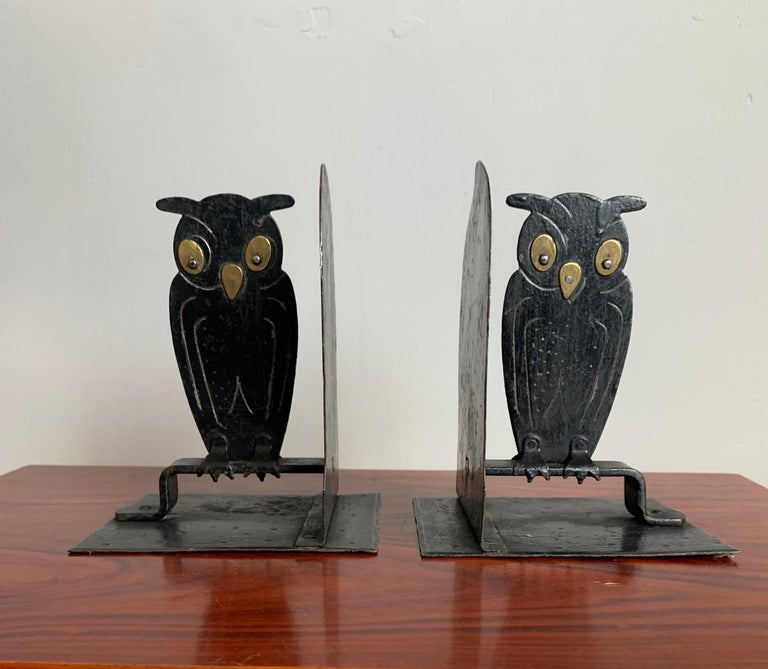 Artistic pair of bookends by famous German metal worker.  These rare and double sided 'Goberg' owl bookends are in good condition. They have a marvelous black finish which makes their eyes stand out even more. These top quality pieces of workmanship