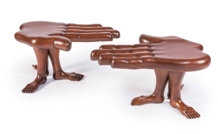A rare pair of hand and foot tables or stools designed and made by Mexican Surrealist artist Pedro Friedeberg in his iconic hand and leg motifs. Made of laminated and blocked mahogany, this pair features a palm supported by three legs with feet.