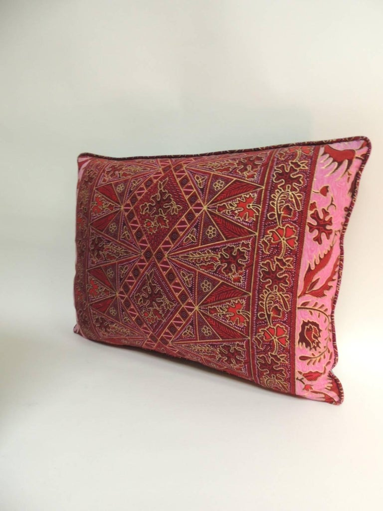Pair of Hand-blocked Red and Pink Batik Bolster Decorative Pillows in shades of pink and red with the same Batik textile trim all around.  Throw lumbar pillows finished with turquoise silk backings.  Diamond pattern in the centre with cranes and