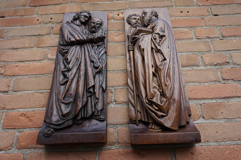 Deeply carved and signed antique oak wall plaques.  If you are looking for fair priced, antique religious art then this rare pair could be ideal for decorating your wall. All hand carved out of solid oakwood these apostels or clergyman are depicted