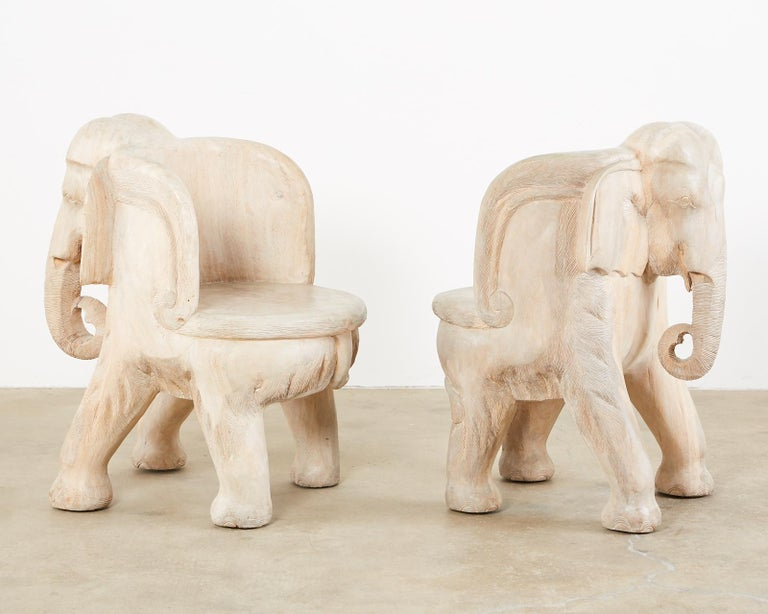 Hand-Crafted Pair of Hand Carved Bleached Hardwood Elephant Chairs For Sale