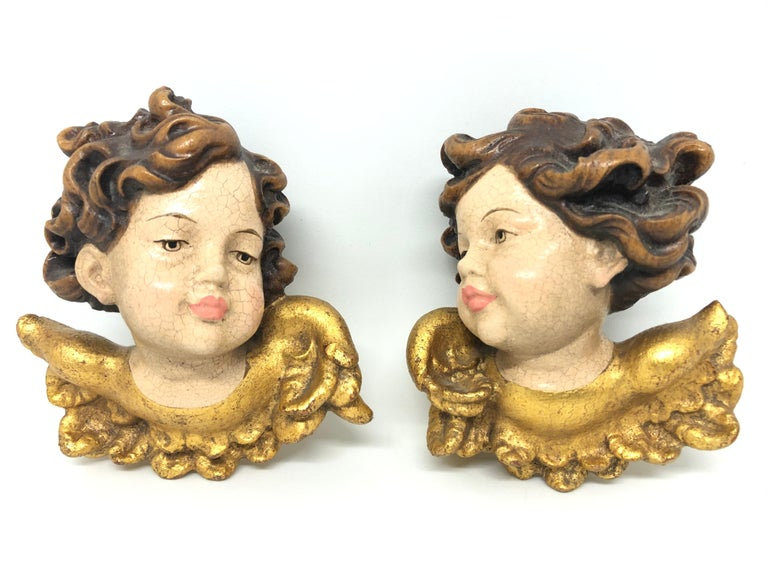Pair of beautiful hand carved cherub angel heads, found at an estate sale in Germany. Made by a woodcarver in the Oberammergau area in Germany, this area is well-known for their wood carvings. We believe that this pieces are from the 1950s or older.