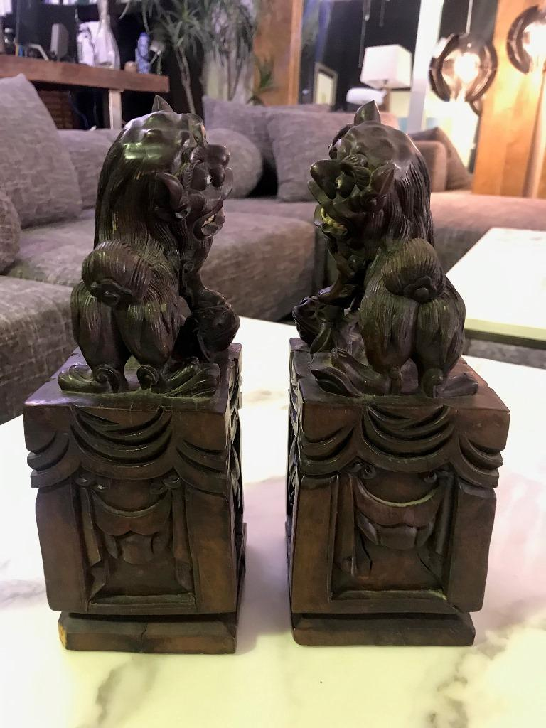 Pair of Hand Carved Chinese Wood Carved, Bone Inlay Foo Dogs, circa Early 1900s In Good Condition For Sale In Studio City, CA