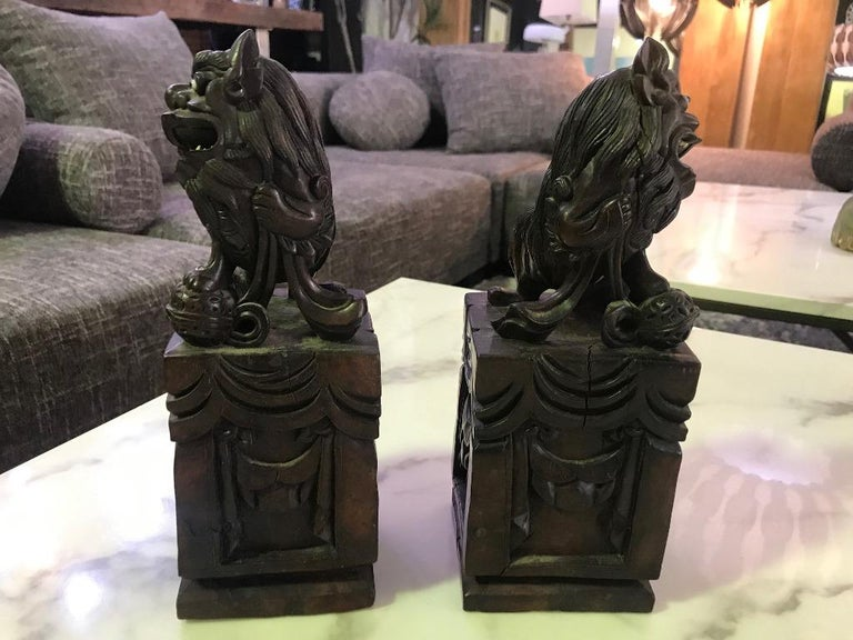 Pair of Hand Carved Chinese Wood Carved, Bone Inlay Foo Dogs, circa Early 1900s For Sale 1