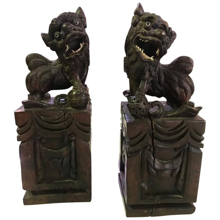 Pair of Hand Carved Chinese Wood Carved, Bone Inlay Foo Dogs, circa Early 1900s For Sale