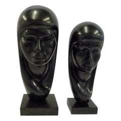 Pair of Hand Carved Ebonized Wood Sculptures of Native Women Signed Arias, 1950s
