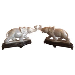 Pair of Hand Carved Elephant Sculptures on Bases in White Jade