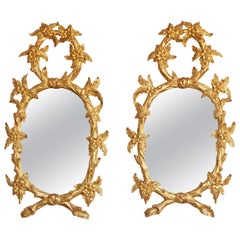 Pair of Hand Carved Oval Gilt Wood Mirrors by La Maison London
