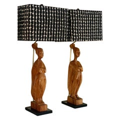 Pair of Hand Carved Wooden African Folk Art Figure Lamps and Custom Woven Shades
