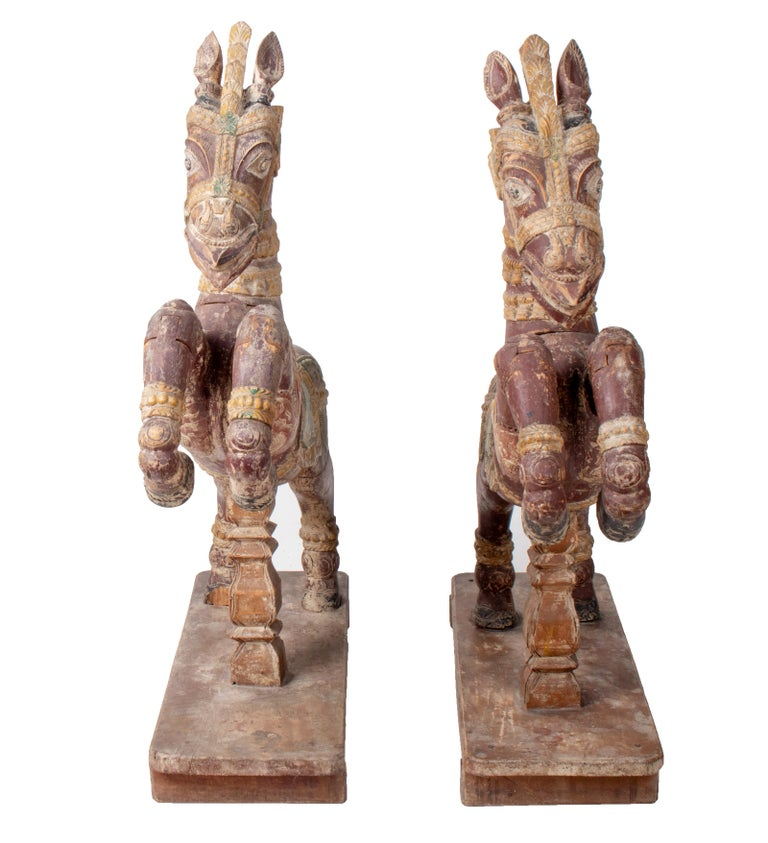 Pair of hand carved wooden painted horses.