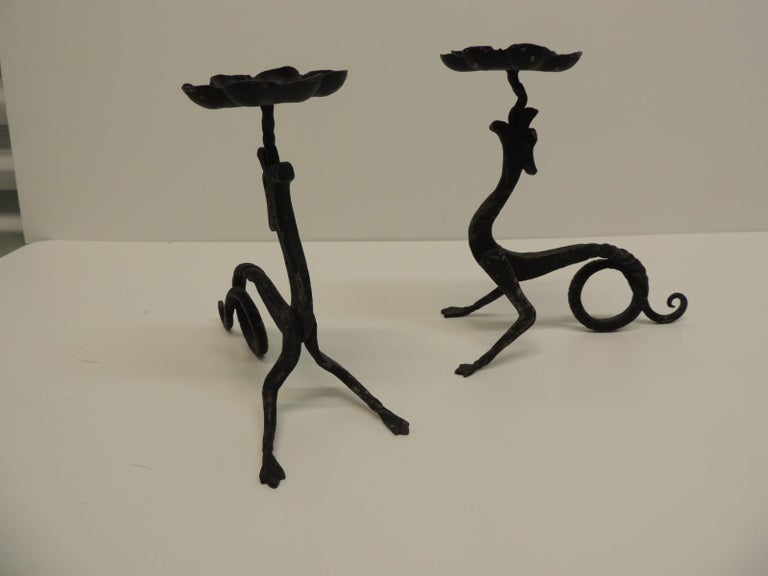 """Pair of hand-forged griffin candleholders with black patina Hand-forged griffin candleholders with black patina. Size: 8 x 7 x 3.5 D Holds up to 2.5"""" candles."""