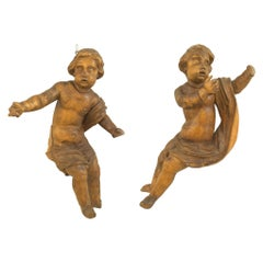Pair of Hanging Italian Rococo Fruitwood Carved Putti Figures