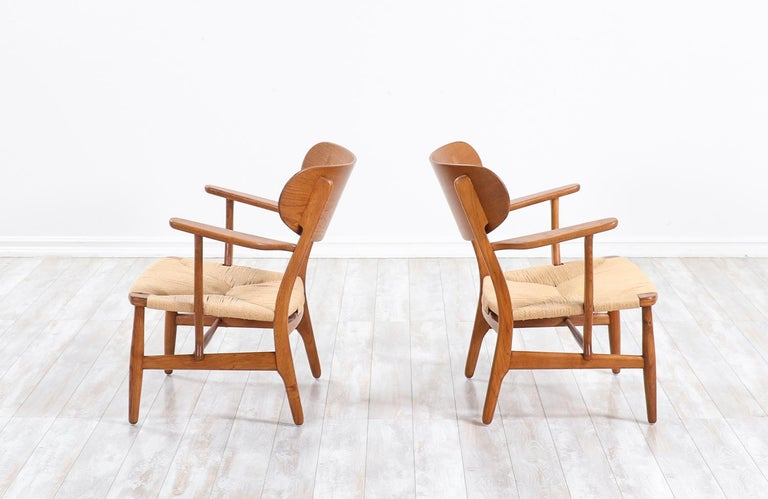 Danish Pair of Hans J. Wegner CH-22 Lounge Chairs for Carl Hansen & Søn For Sale