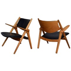 Pair of Hans J. Wegner CH28 Sawbuck Lounge Chairs, Denmark, circa 1950