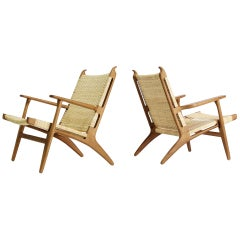 Pair of Hans J. Wegner Lounge Chairs Model CH-27 in Oak & Cane Carl Hansen & Son