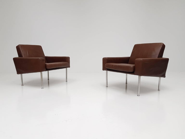 Stunning pair of Hans J. Wegner airport chairs model 34/1 on steel legs. These come with the original leather, hard to find chairs, great looking and comfortable.  Hans J. Wegner was certified as a joiner in 1931. After starting his career as a