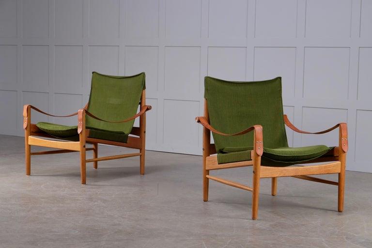 Produced by Viska Möbler in Kinna, Sweden, 1960s. Original green upholstery.