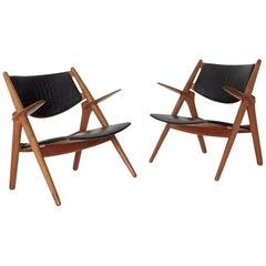 Pair of Hans Wegner CH 28 Sawbuck Armchairs, Denmark