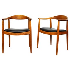 Pair of Hans Wegner for Johannes Hansen Oak and Black Leather Round Chairs