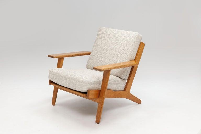 Danish Pair of Hans Wegner Lounge Chairs GE290 by GETAMA For Sale