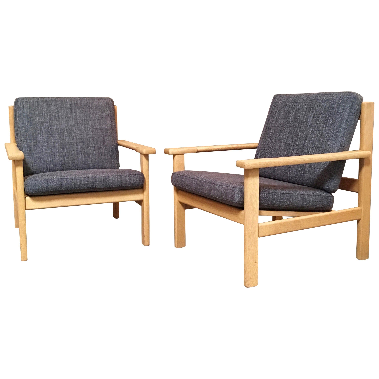 Pair of Hans Wegner Lounge Chairs in Oak