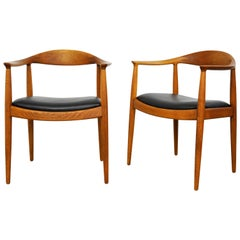 Pair of Hans Wegner Oak and Black Leather Round Chairs