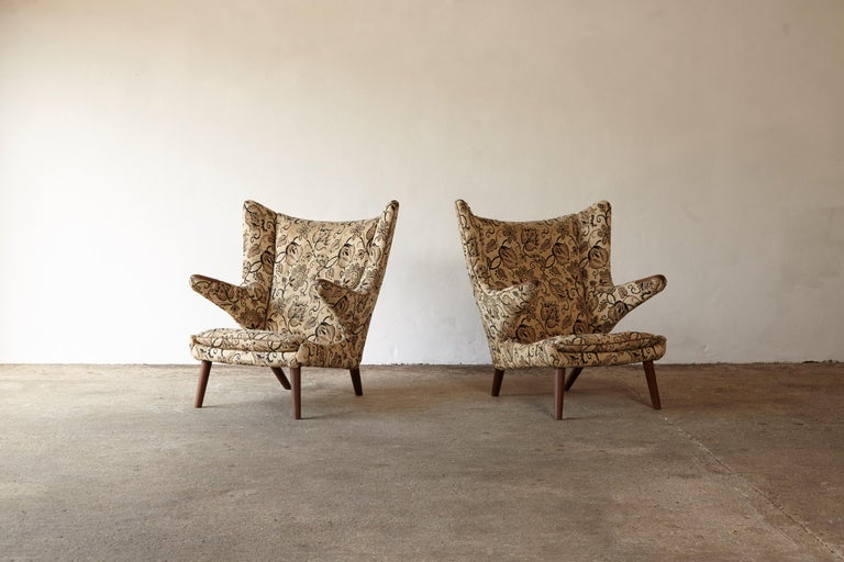 An original pair of Hans Wegner papa bear chairs designed in 1947 and produced by AP Stolen in Denmark in the 1950s. The fabric is damaged so these are offered in their current original condition for the customer to upholster in their own choice of