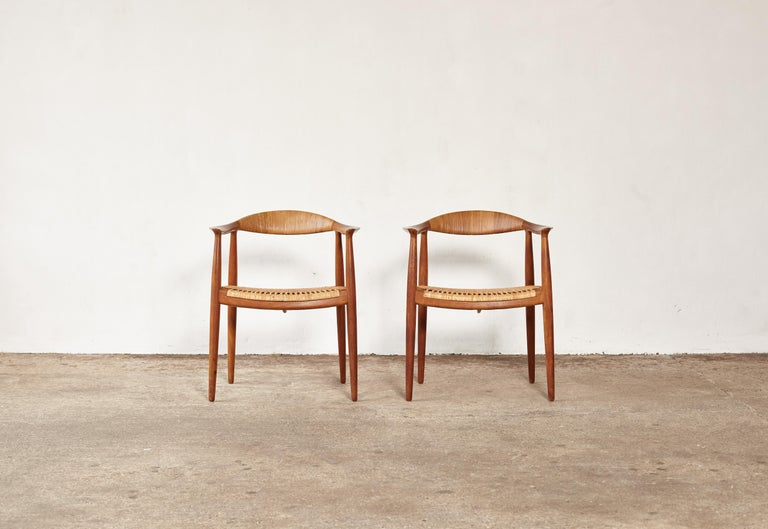 A fine pair of Hans Wegner's iconic 'The Chair', designed in 1949, model JH 501, made by Johannes Hansen, Denmark. This is the earliest version in mahogany with cane seat and backrest. Branded with makers mark.