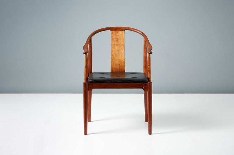 Hans J. Wegner  FH 4283 China chair, 1944  This incredibly rare version of Wegner's iconic design was produced by Fritz Hansen in Denmark in 1977 in exquisite European walnut in an edition of just 250. Each chair is numbered with a metal plaque.