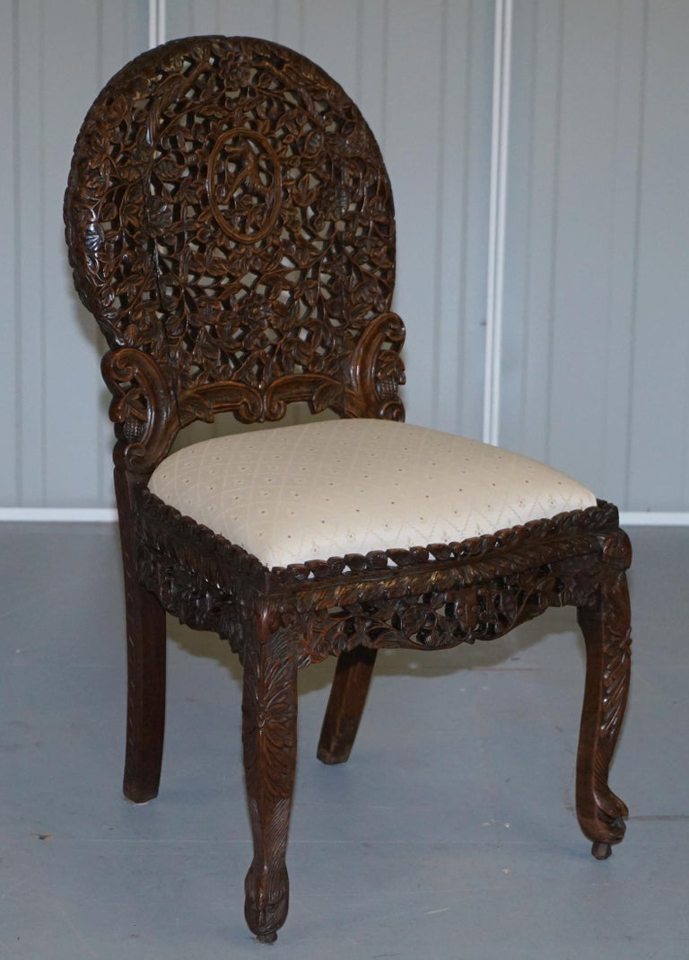 We are delighted to offer for sale this is for an original pair of solid Hardwood Anglo-Indian Burmese hand carved chairs  A very rare find, you see singles pop up every now and again but rarely an original a pair. The condition is good, they have