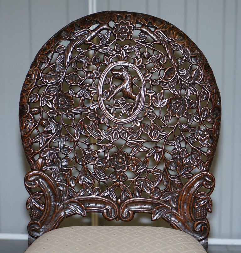 Anglo-Indian Pair of Hardwood Hand Carved Anglo Indian Burmese Chairs with Floral Detailing For Sale