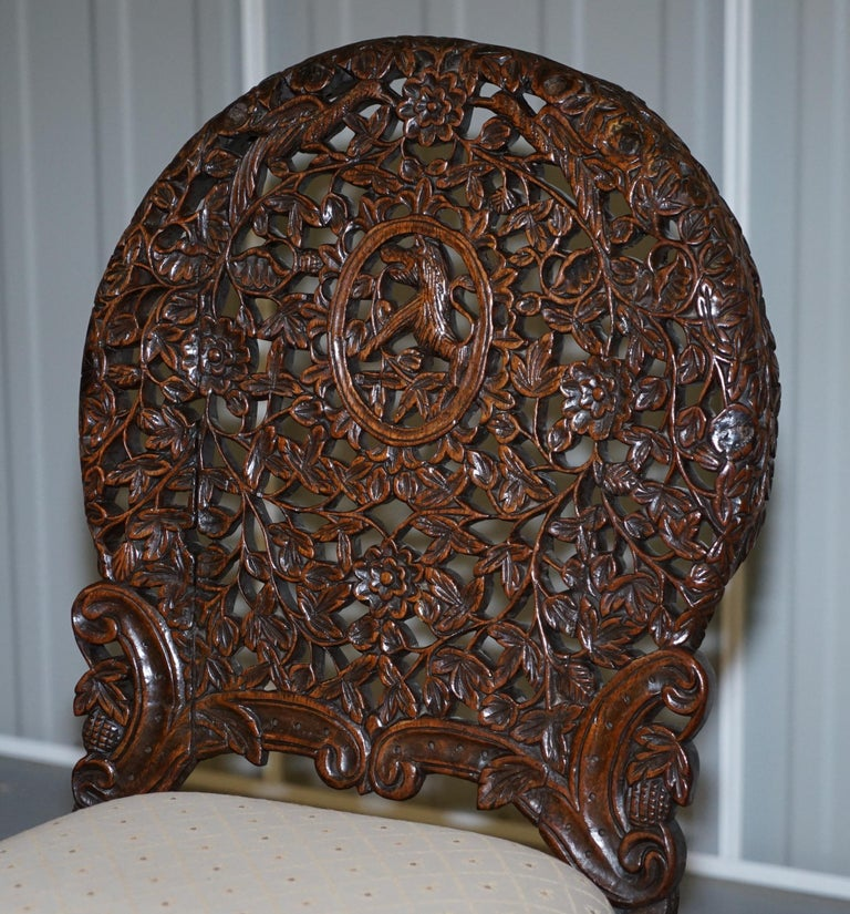 Hand-Crafted Pair of Hardwood Hand Carved Anglo Indian Burmese Chairs with Floral Detailing For Sale