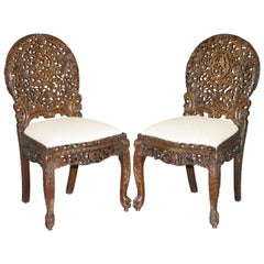 Pair of Hardwood Hand Carved Anglo Indian Burmese Chairs with Floral Detailing
