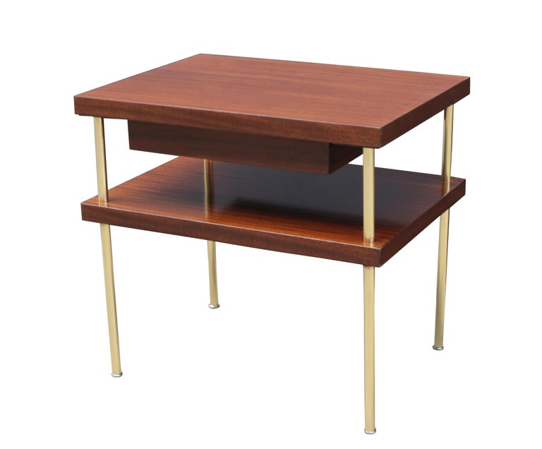 A pair of Harvey Probber designed end tables. Mahogany with brass legs. Each with single utility drawer.