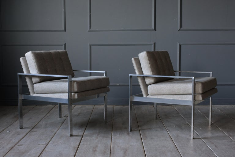 This 1960s pair of Harvey Probber lounge chairs belonged and were used at The Washington Post's main offices during 1970s. The comfortable chairs have recently been professionally upholstered in a light grey color fabric, and the loose seat and back