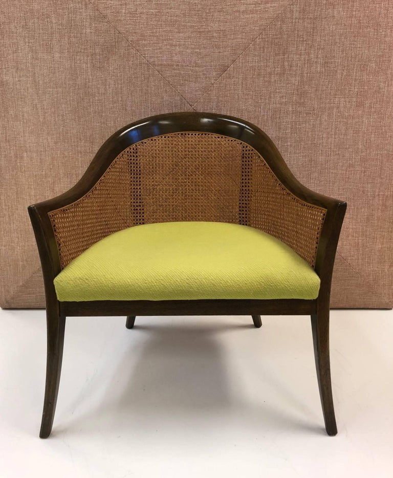 Pair of Harvey Probber side or lounge chairs. Chairs have mahogany and caned frames.