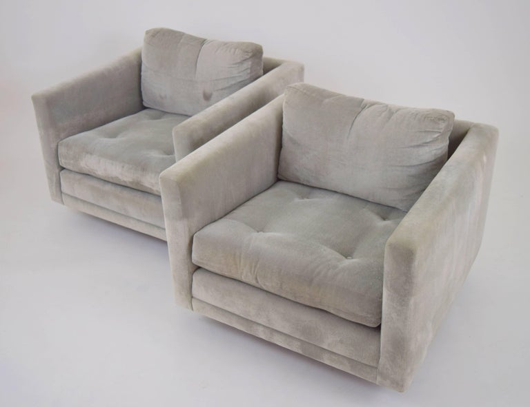 Minimalist pair of swivel cube chairs by Harvey Probber on round walnut bases. Button tufted seats and down cushion blend backs previously upholstered in a silver velvet corduroy.