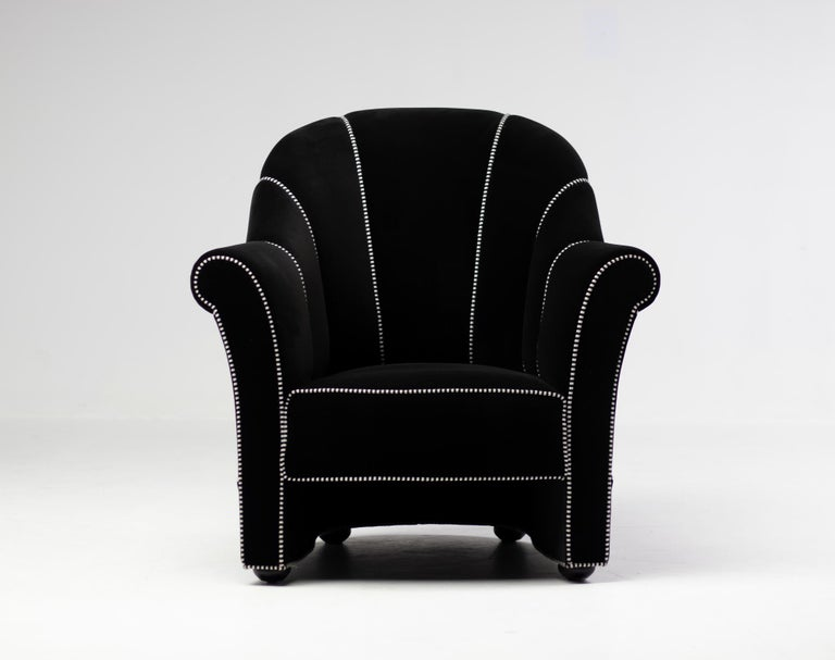 Pair of armchairs designed by Josef Hoffmann and made by Wittmann, Austria.  Originally designed for the Koller House in 1911. Black velvet with black and white welting.  Marked with label and bronze plaque underneath the chair.