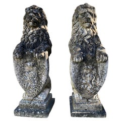 Pair of Heavily-Weathered and Lichened English Cast Stone Armorial Lions
