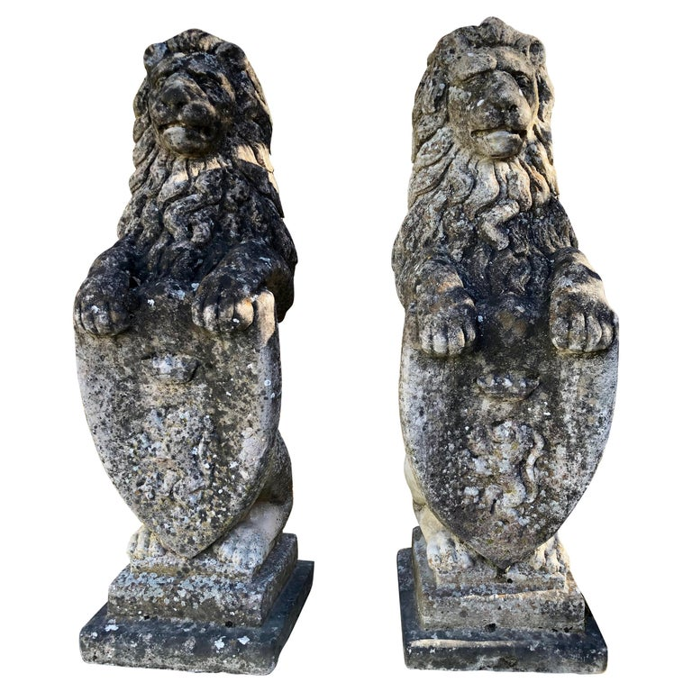 Pair of Heavily-Weathered and Lichened English Cast Stone Armorial Lions For Sale