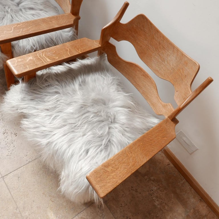 Wood Pair of Henning Kjaernulf Danish Mid-Century Oak 'Razorblade' Sheepskin Armchair