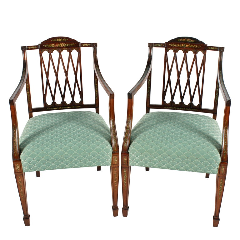 A fine pair of late 19th century Hepplewhite style mahogany elbow chairs.