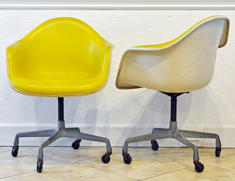 Mid-Century Modern Pair of Herman Miller Upholstered Shell Swivel Chairs by Charles and Ray Eames For Sale